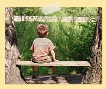 Image of boy sitting on bench