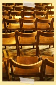 Image of rows of wooden chairs
